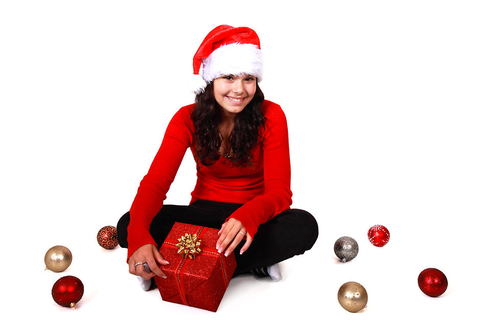 9084-a-beautiful-young-woman-with-a-christmas-gift-on-a-white-background-pv